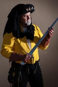 Oskar Hasselhoff examing his sword.
